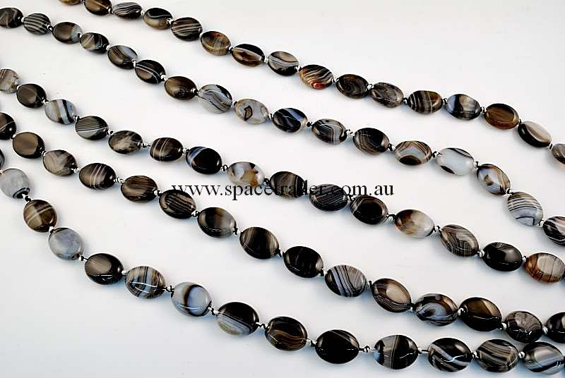 Agate - 12x16mm Puffed Oval Black Banded Agate in 22 Pcs a Strand